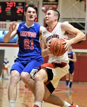 Rosecrans' Marcus Browning drives against Lakewood's Zaven Boland in Wednesday's game at Rogge Gymnasium. The Bishops won 67-53.