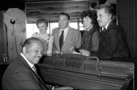 Helen Ward, Bob Eberle, Fran Warren, Johnny Desmond and band leader Sy Oliver, at piano, gathered to celebrate the 45th anniversary of the Rainbow Room in New York in 1979.
