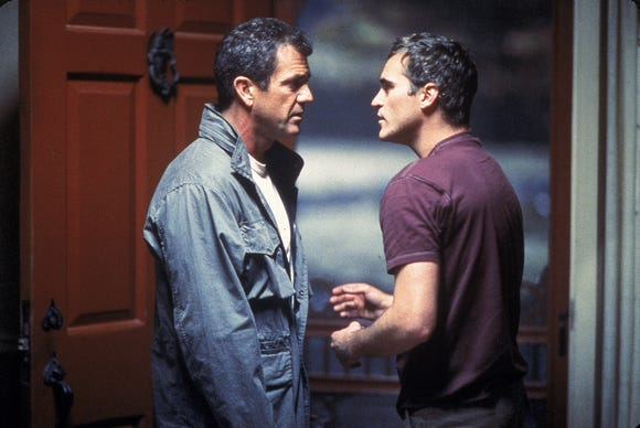 "Mel GIbson (left) and Joaquin Phoenix are farm dudes dealing with an alien invasion in ""Signs."""