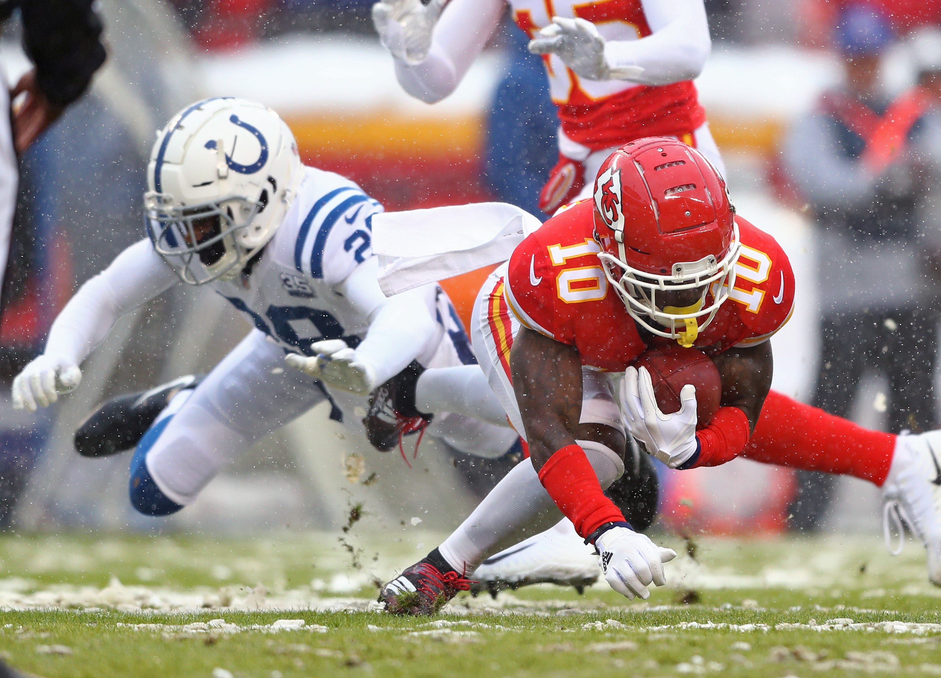 Jan. 12, 2019: Kansas City Chiefs wide receiver Tyreek Hill dives for more yardage during an AFC divisional playoff game against the Indianapolis Colts at Arrowhead Stadium. The Chiefs won the game, 31-13, for the team's first home playoff win in 25 years.