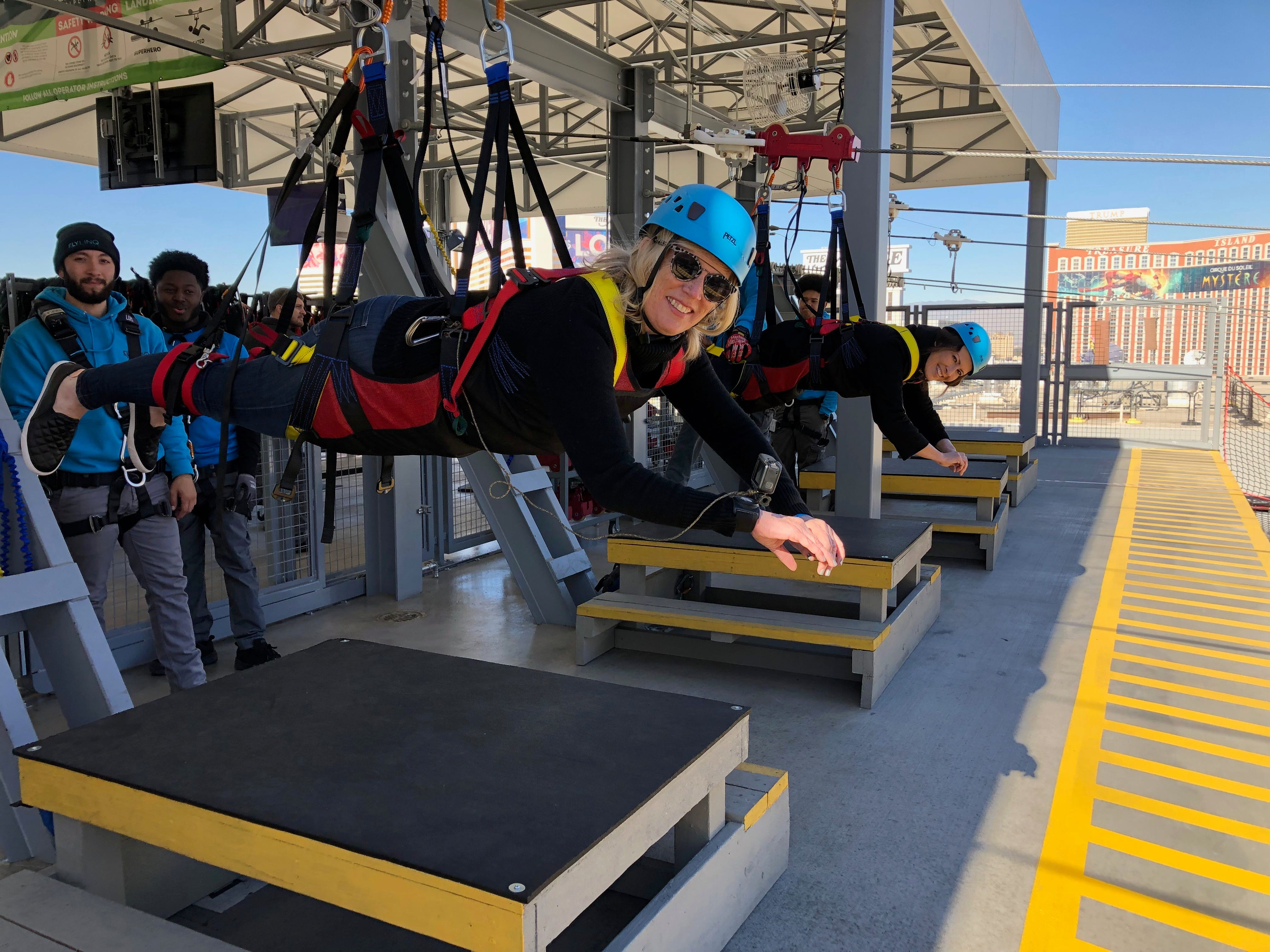 USA TODAY travel reporter Dawn Gilbertson preparing for takeoff, superhero style, at the new Fly Linq zipline on the Las Vegas Strip.