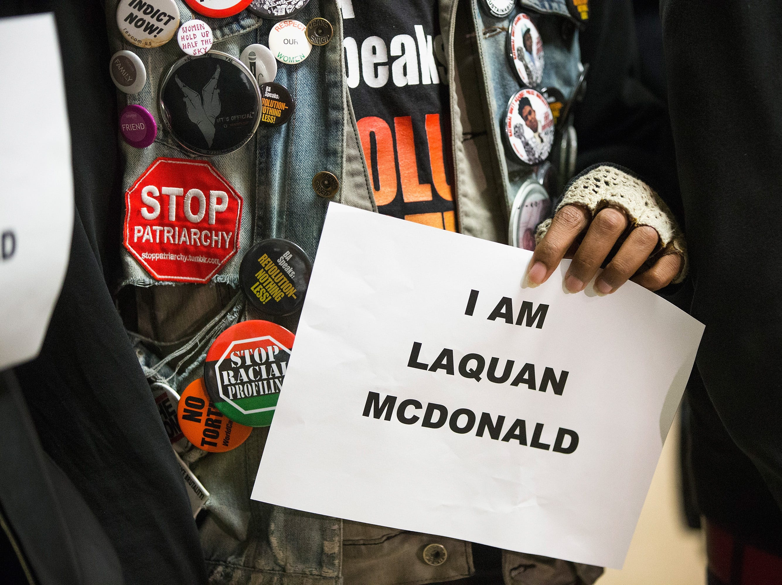 Demonstrators protest the shooting death of Laquan McDonald by a Chicago police officer outside the mayor's office in City Hall on Dec. 7, 2015 in Chicago, Illinois.