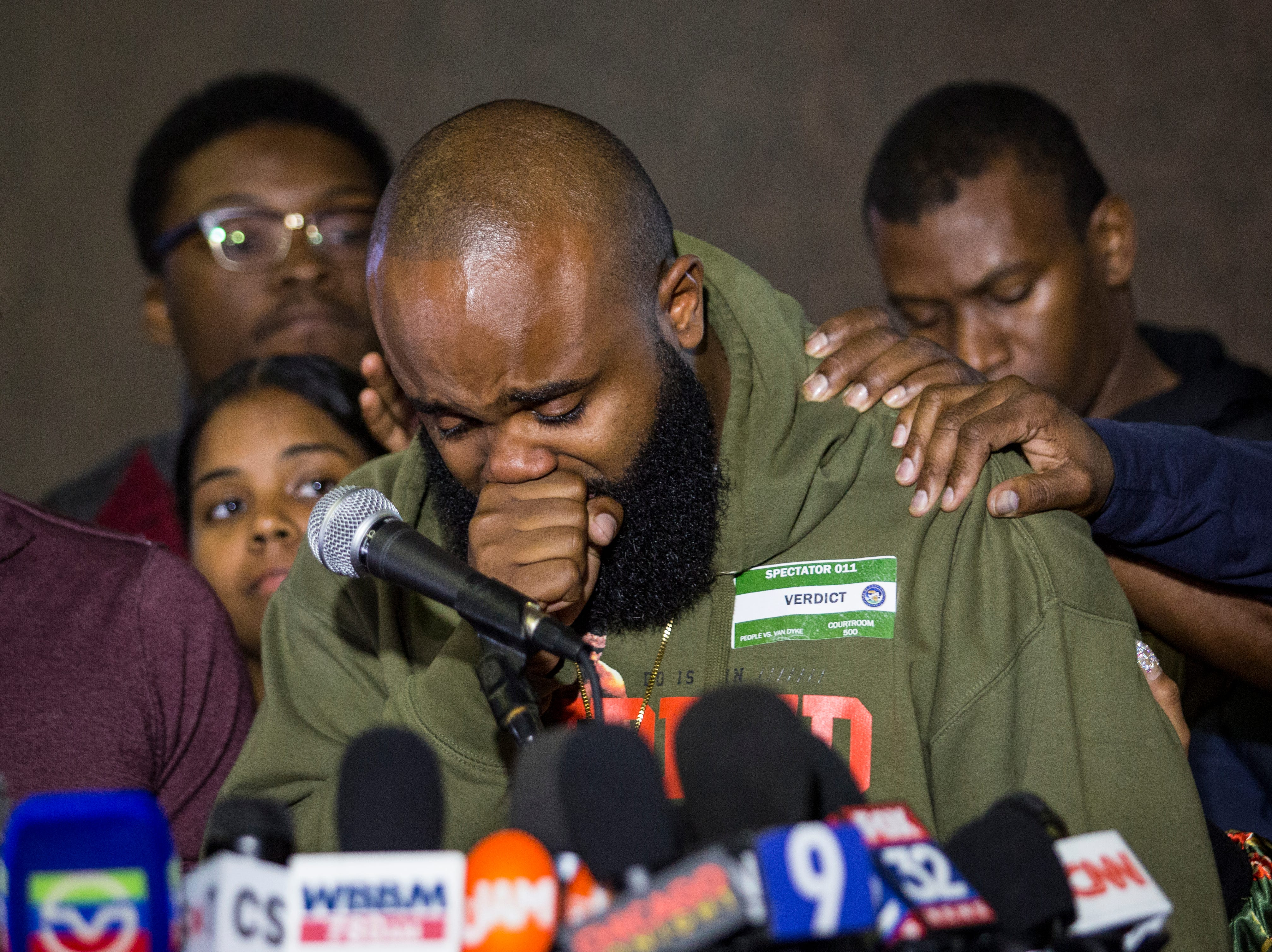 Community activist William Calloway gets emotional as he speaks to reporters at the Leighton Criminal Courthouse, Friday, Oct. 5, 2018, in Chicago, after jury found white Chicago police Officer Jason Van Dyke guilty of second-degree murder and aggravated battery in the 2014 shooting of black teenager Laquan McDonald.