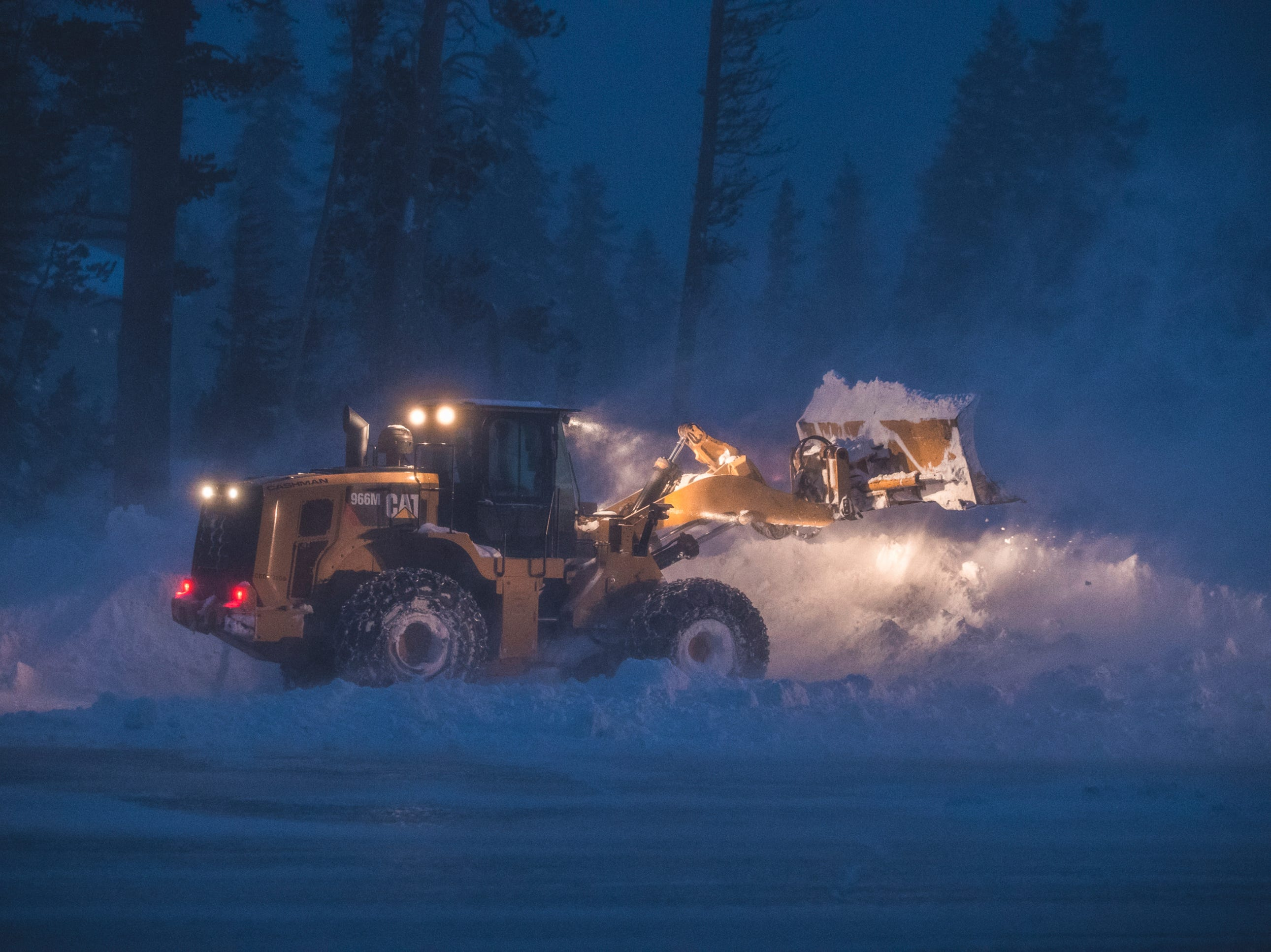 This photo provided by Mammoth Mountain Ski Area shows crew clearing fresh snow fall at Mammoth Mountain ski area, in Mammoth Lakes, Calif., Wednesday, Jan. 16, 2019.