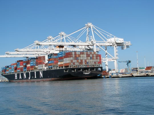 Shipping containers being unloaded at the Port of Oakland in California.