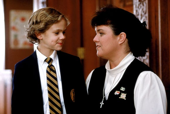 "A Catholic school kid (Joseph Cross, left, with Rosie O'Donnell) seeks to find God in ""Wide Awake"""