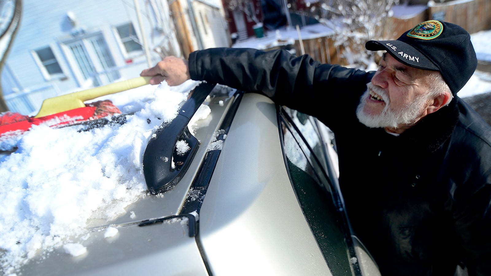 Anibal Maceira, of Hagerstown, Md., cleans snow off the roof of his car Monday morning, Jan. 14, 2019, after a winter storm brought about six inches of snow to the Tri-State area over the weekend.