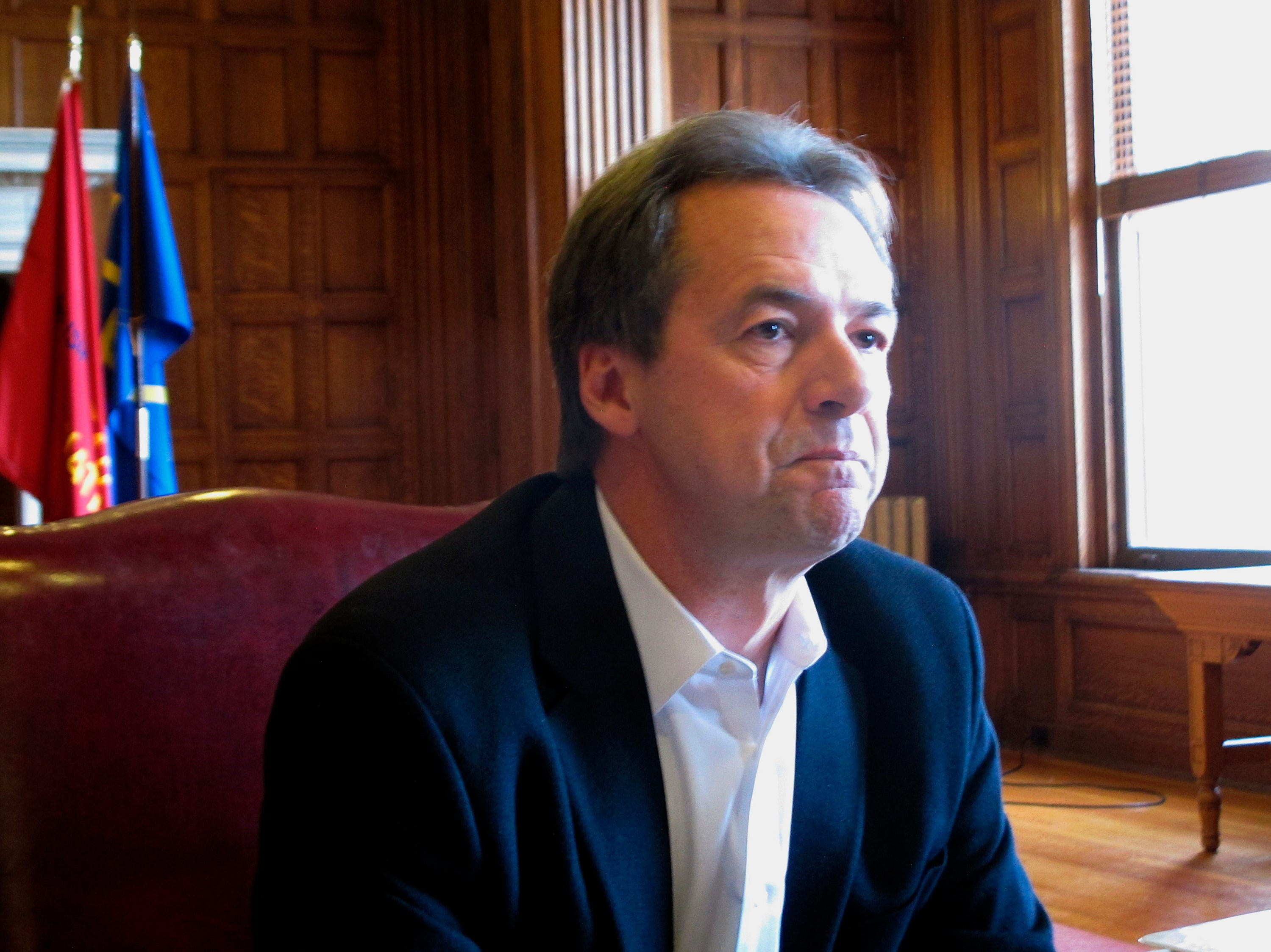 Montana Gov. Steve Bullock listens to a question during a news conference on Wednesday, Jan. 16, 2019, in Helena, Mont.. Bullock declined to say whether he plans to run for president in 2020, saying he is focused on the legislative session that began last week. (AP Photo/Matt Volz)