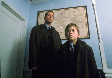 "Bruce Willis is a child psychologist and Haley Joel Osment is a kid who sees ghosts in ""The Sixth Sense."""