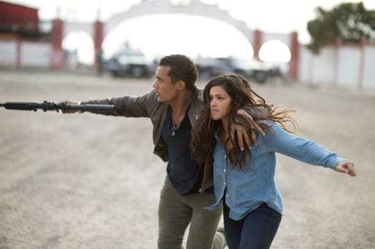 "In ""Miss Bala,"" Gina Rodríguez plays Gloria, a woman captured by a Mexican cartel leader (Ismael Cruz)."