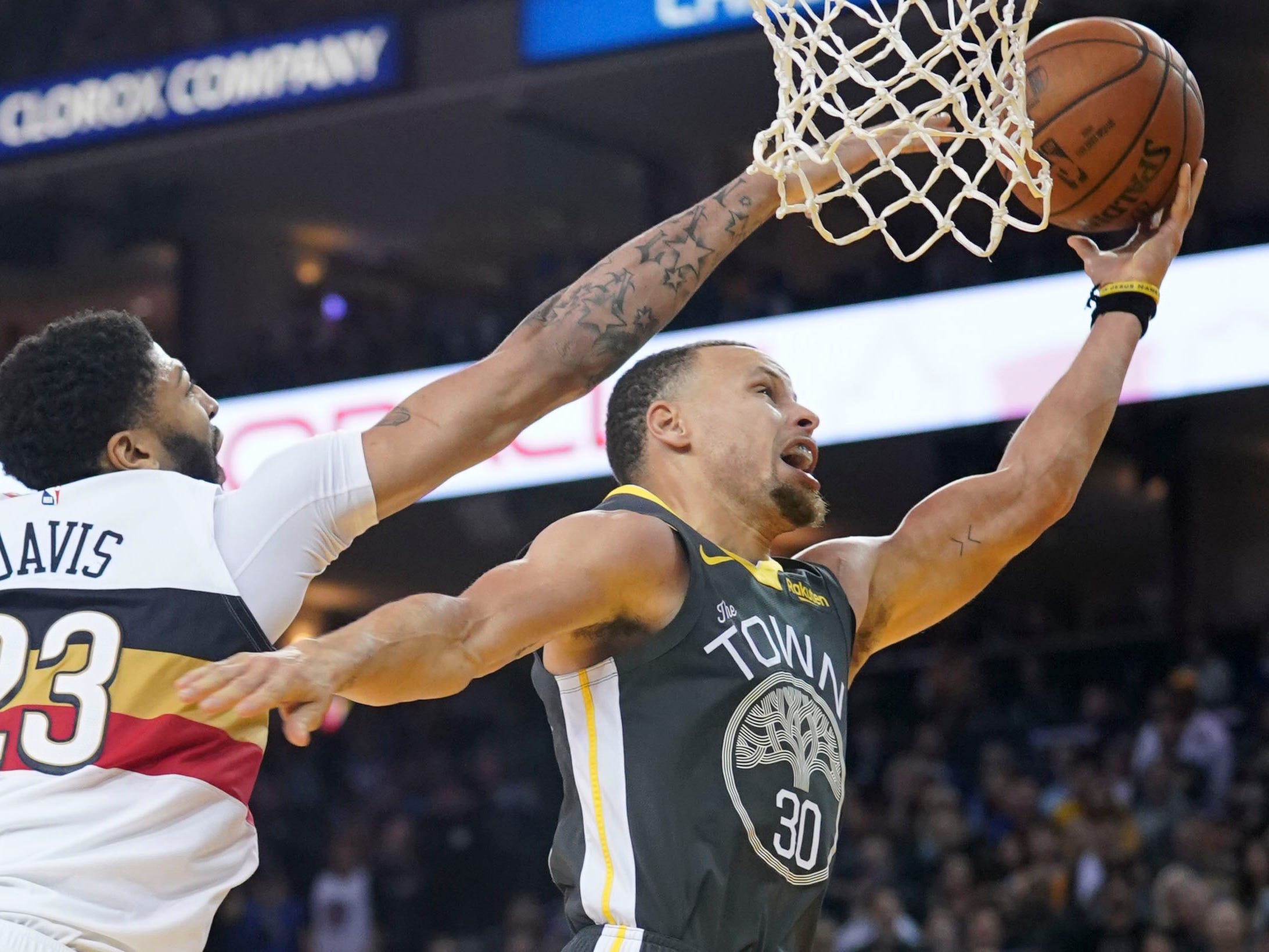 Jan. 16: Warriors guard Stephen Curry (30) drives to the bucket against Pelicans defender Anthony Davis (23) during the fourth quarter at Oracle Arena in Oakland.