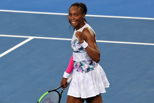 Venus Williams celebrates her victory against France's Alize Cornet during their women's singles match on day four of the Australian Open on Jan. 17.