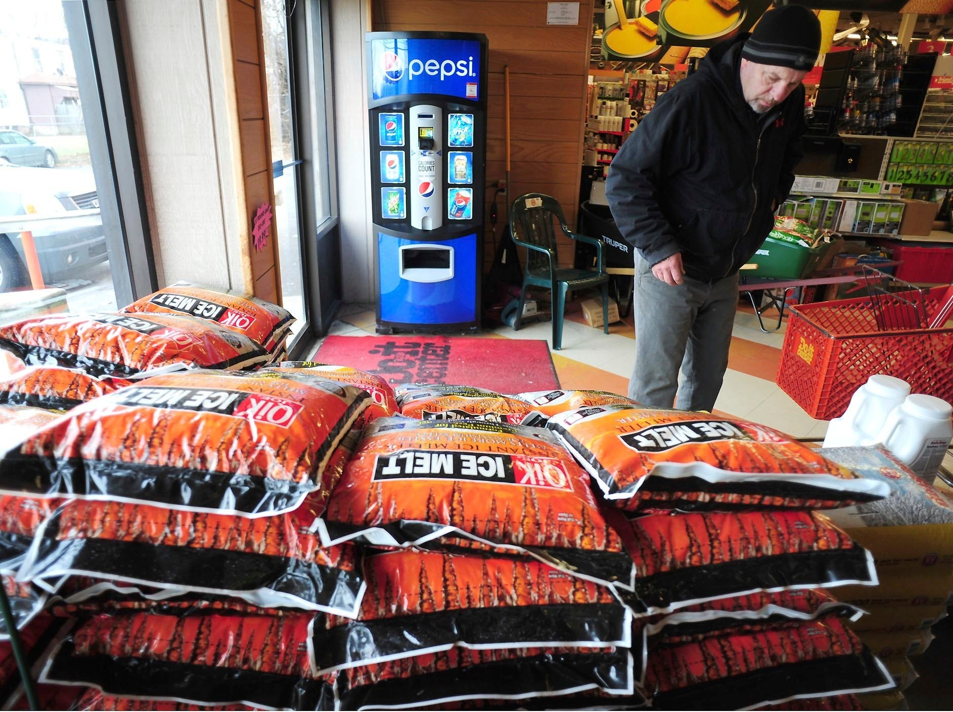 Customers purchase rock salt and ice melt Thursday, Jan. 17, 2019, at Walter's Hardware in Wilkes-Barre Township, Pa. Customers were also out purchasing rock salt and ice melt Thursday, in preparation for a forecasted weekend snow storm across Pennsylvania and surrounding states.