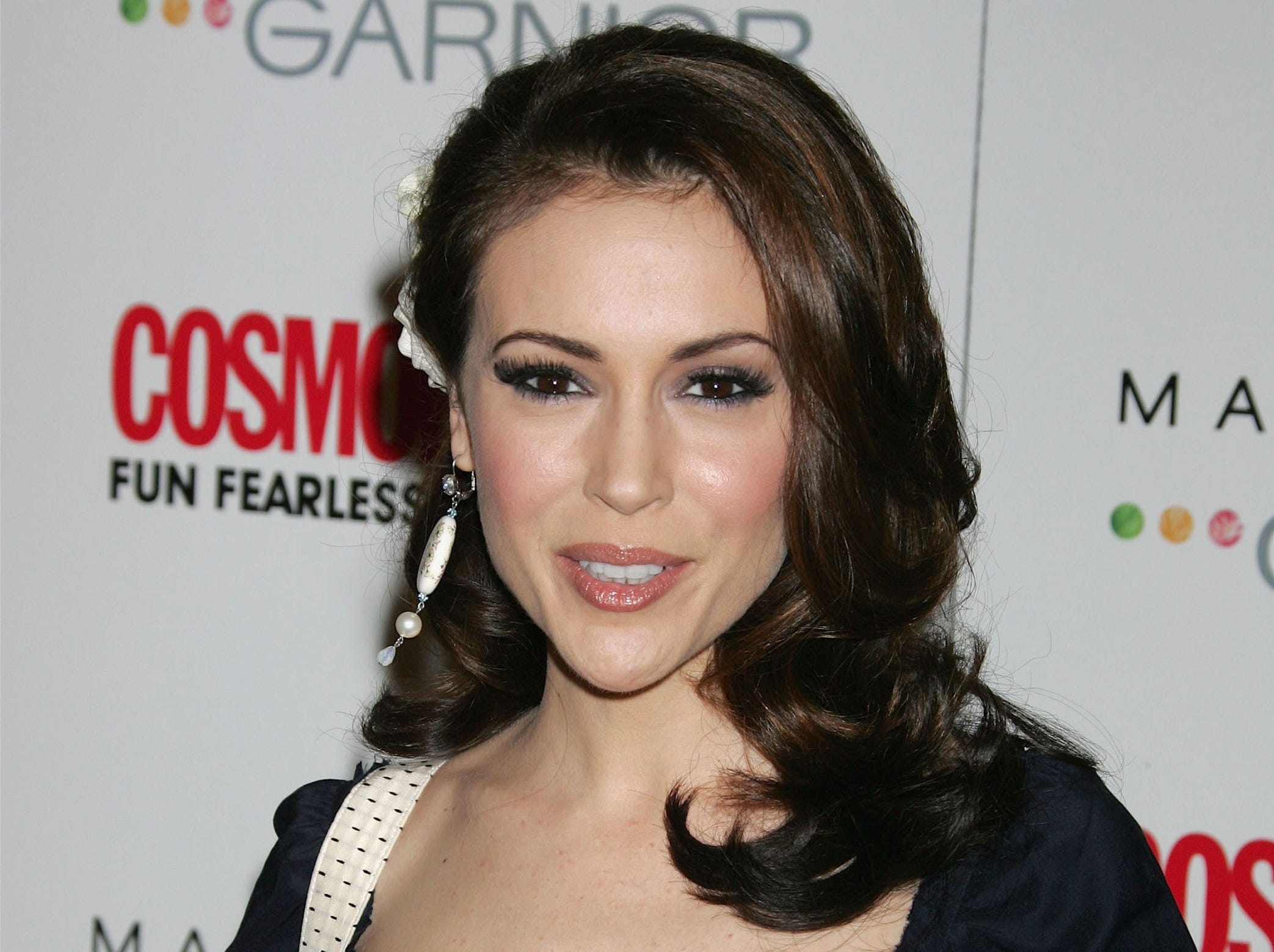 HOLLYWOOD - FEBRUARY 13:  Actress Alyssa Milano poses at Cosmopolitan Magazine's celebration honoring actor Patrick Dempsey as Fun Fearless Male of the Year at the Day After Nightclub on February 13, 2006 in Hollywood, California. (Photo by David Livingston/Getty Images) *** Local Caption *** Alyssa Milano ORG XMIT: 56798650 GTY ID: 98650DL064_Cosmo_Arrive
