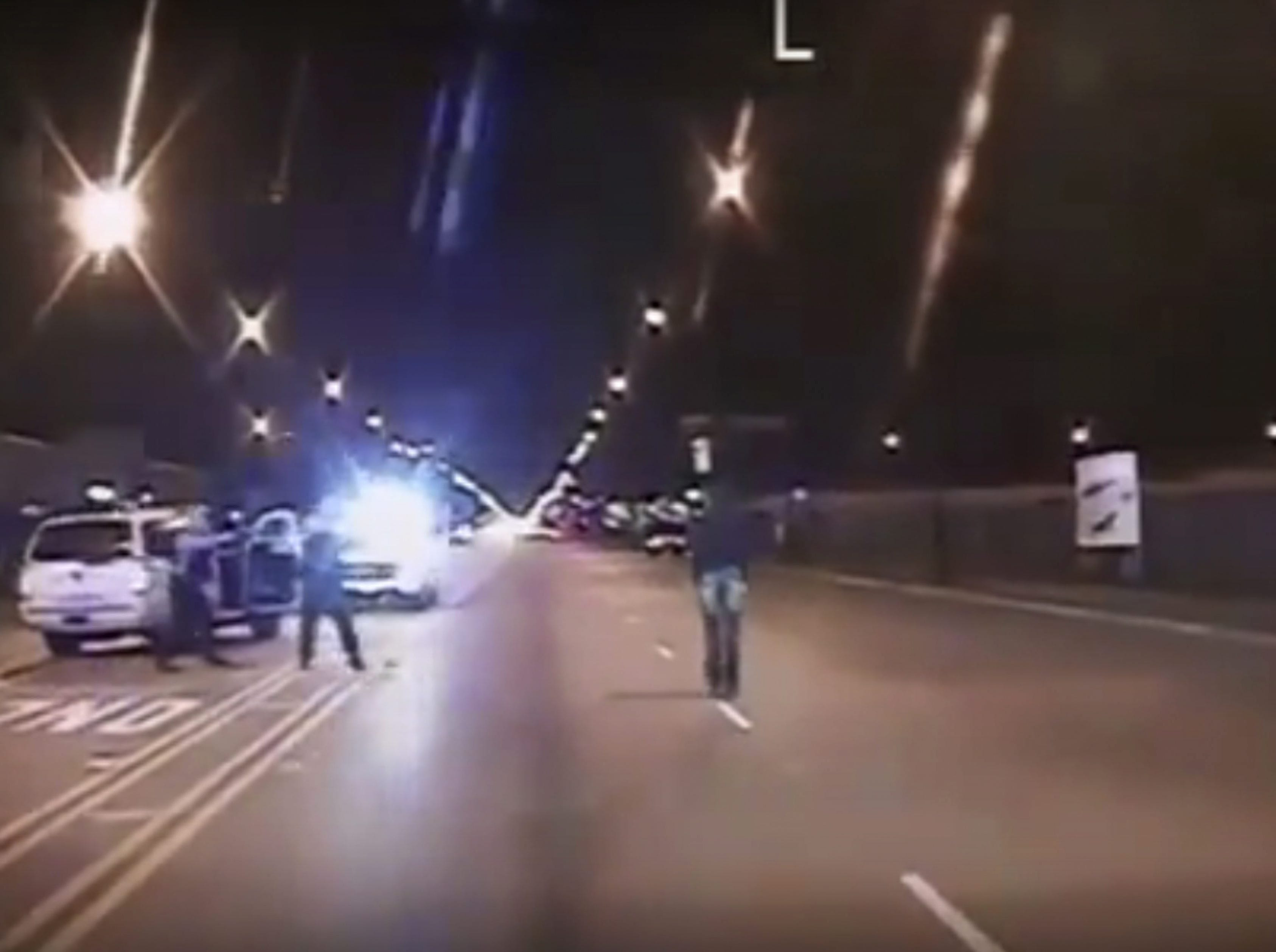 A frame grab from a dash cam video released by the Chicago Police on Nov. 24, 2015 which shows the fatal shooting of 17 year-old Laquan McDonald, center, by Chicago police officers, left, in Chicago, Ill. Oct. 20, 2014. Chicago police officer Jason Van Dyke was charged with first-degree murder on Nov. 24, 2015. He allegedly shot Laquan McDonald 16 times, continuing fire after the teenager fell to the ground, and stopped only after another police officer told him to do so. A police video of the shooting was released on 24 November, and the police force had ordered officers to prepare for possible protests, the Chicago Tribune newspaper reported. Cook Country State's Attorney Anita Alvarez had taken more than a year to investigate the incident before filing the murder charge, but said she moved to file charges ahead of the video's release. Van Dyke has turned himself in and was being held without bail. The police union has said Van Dyke acted in fear of his life after McDonald lunged at him with a knife.