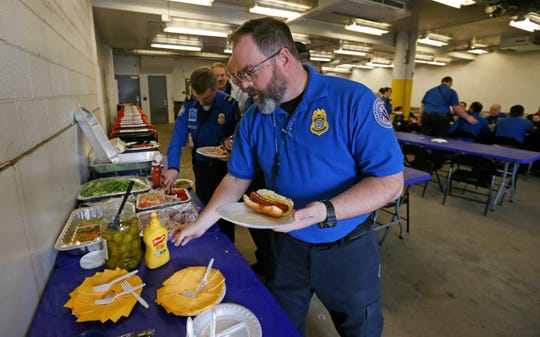 TSA employee Gary Vetterli prepares a hot dog during lunch at Salt Lake City International Airport on Jan. 16, 2019.