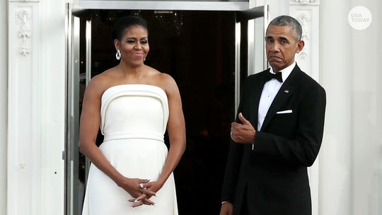 President Barack Obama gives thumbs up to former first lady Michelle.