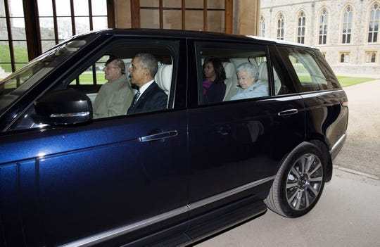 Prince Philip drives, with President Barack Obama, first lady Michelle Obama and Queen Elizabeth II as passengers, in the Quadrangle of Windsor Castle on April 22, 2016, when the Obamas joined the royals for a private lunch.