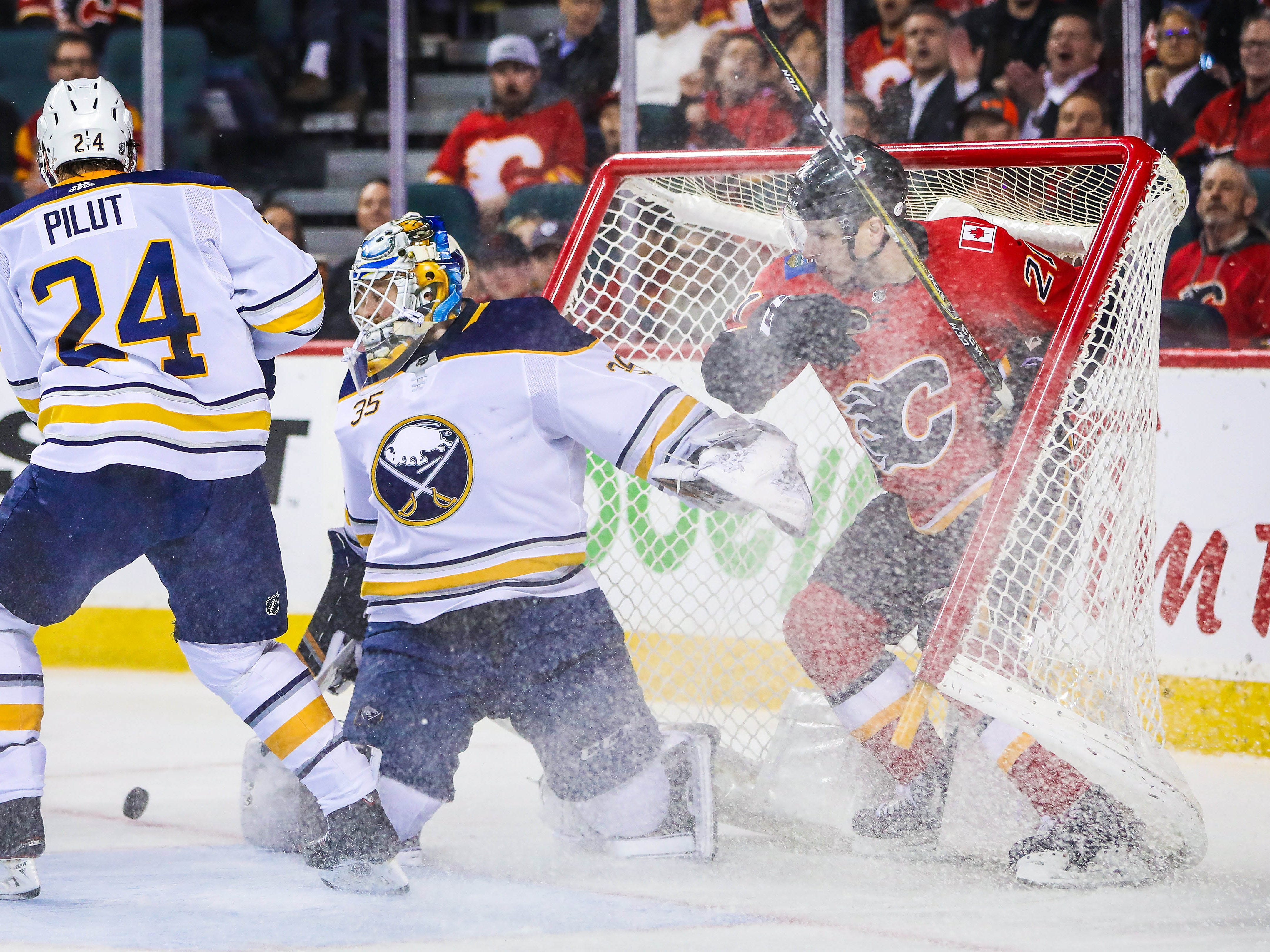 Jan. 16: The Calgary Flames' Garnet Hathaway and Buffalo Sabres goaltender Linus Ullmark collide during the first period at Scotiabank Saddledome.