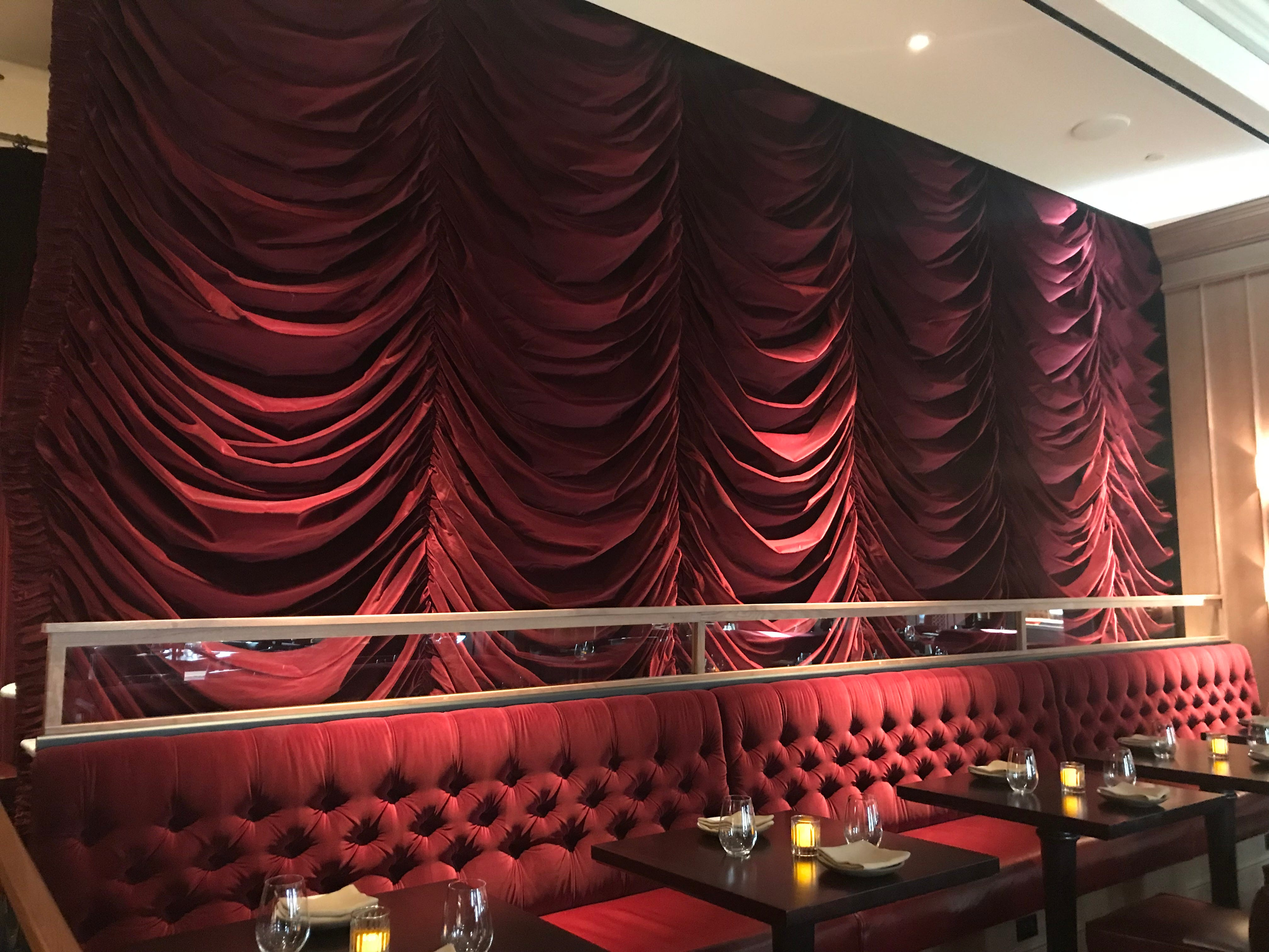 Had a rough night? A velvet curtain hides the bar at NoMad Bar during breakfast at the restaurant.