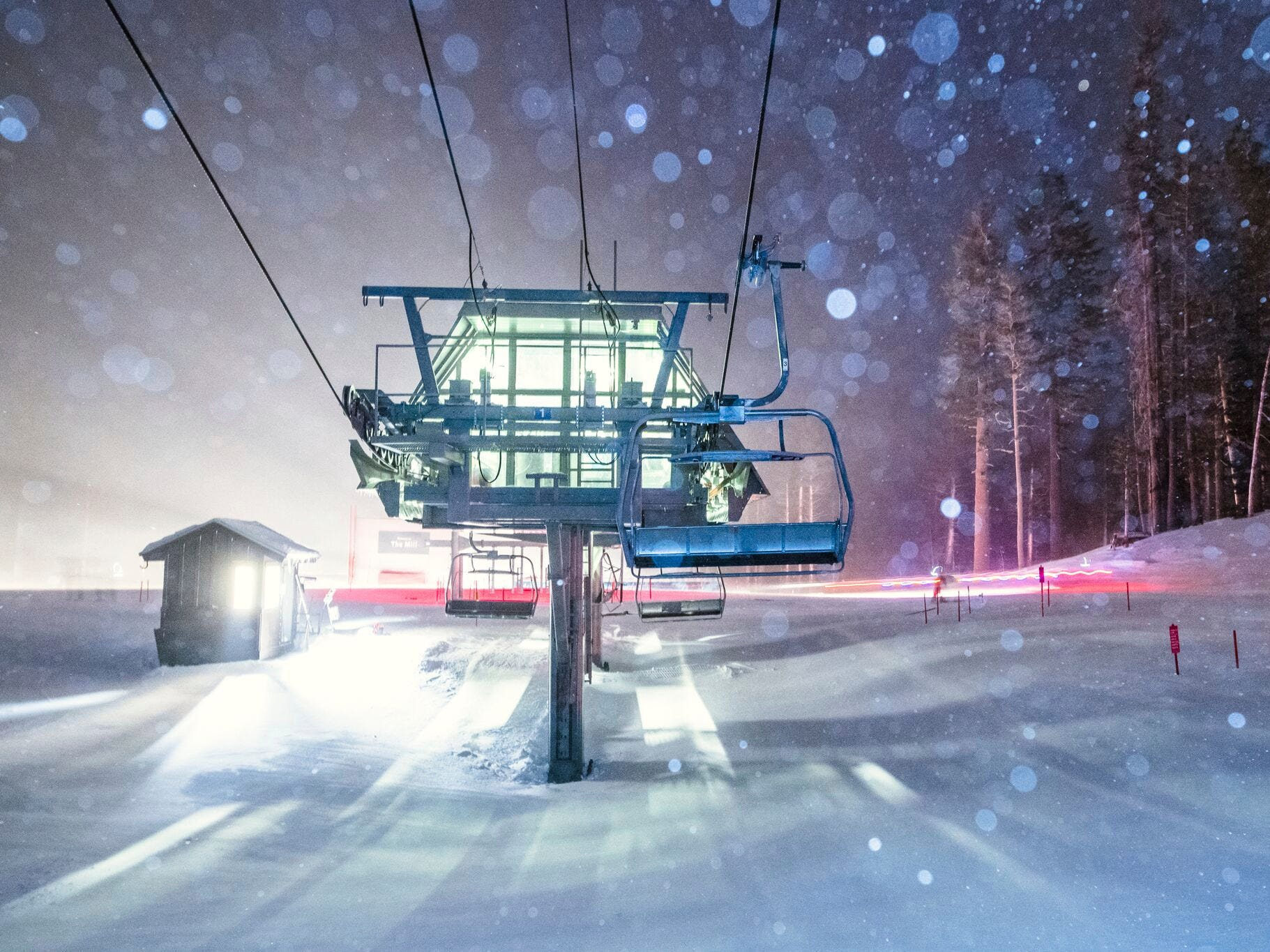 This photo provided by Mammoth Mountain Ski Area shows fresh snow fall over one of the chair lifts at Mammoth Mountain Ski Area in Mammoth Lakes, Calif., Wednesday, Jan. 16, 2019. A Pacific storm that brought fears of dangerous mudslides and a rare blizzard warning in the Sierra Nevada was less fierce than expected but hundreds of homes in fire-scarred California areas remained under evacuation orders as more rain was expected.
