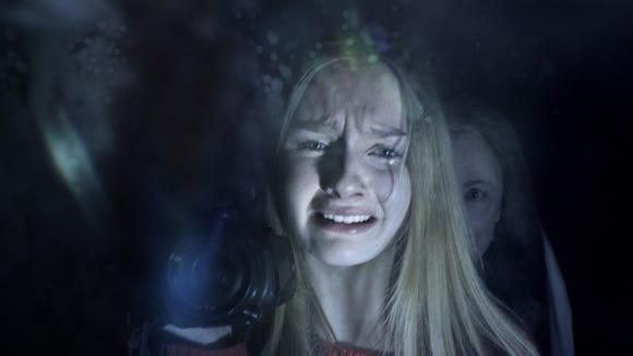 "Becca (Olivia DeJonge) hides from Nana (Deanna Dunagan) in ""The Visit."""