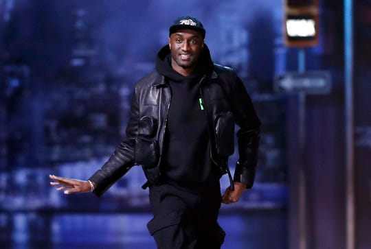 Designer Virgil Abloh appears on the catwalk after the presentation of his Fall/Winter 2019/2020 Men's collection for Louis Vuitton during the Paris Fashion Week, in Paris, France, on Jan. 17, 2019.
