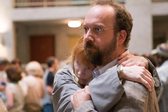 "Story (Bryce Dallas Howard, left) is protected by Cleveland (Paul Giamatti in ""Lady in the Water."""