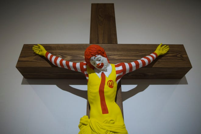 "An artwork called ""McJesus,"" which was sculpted by Finnish artist Jani Leinonen and depicts a crucified Ronald McDonald, is seen on display as part of the Haifa museum's ""Sacred Goods"" exhibit, in Haifa, Israel, Monday, Jan. 14, 2019. Hundreds of Christians calling for the sculpture's removal protested at the museum last week."