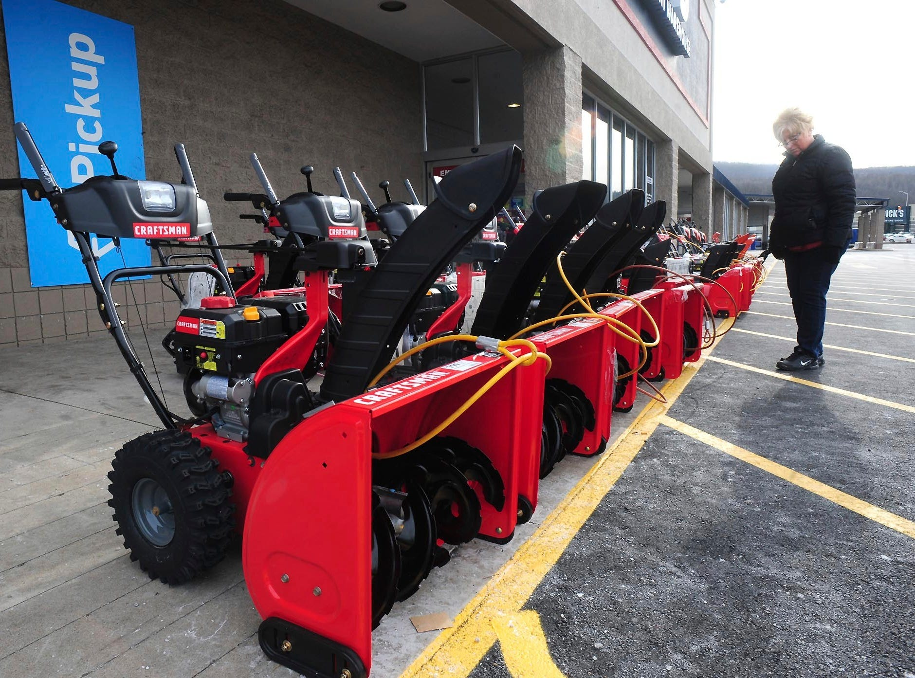 Lisa Zielecki looks over snow throwers at Lowe's, Thursday, Jan. 17, 2019, in Wilkes-Barre Township, Pa.