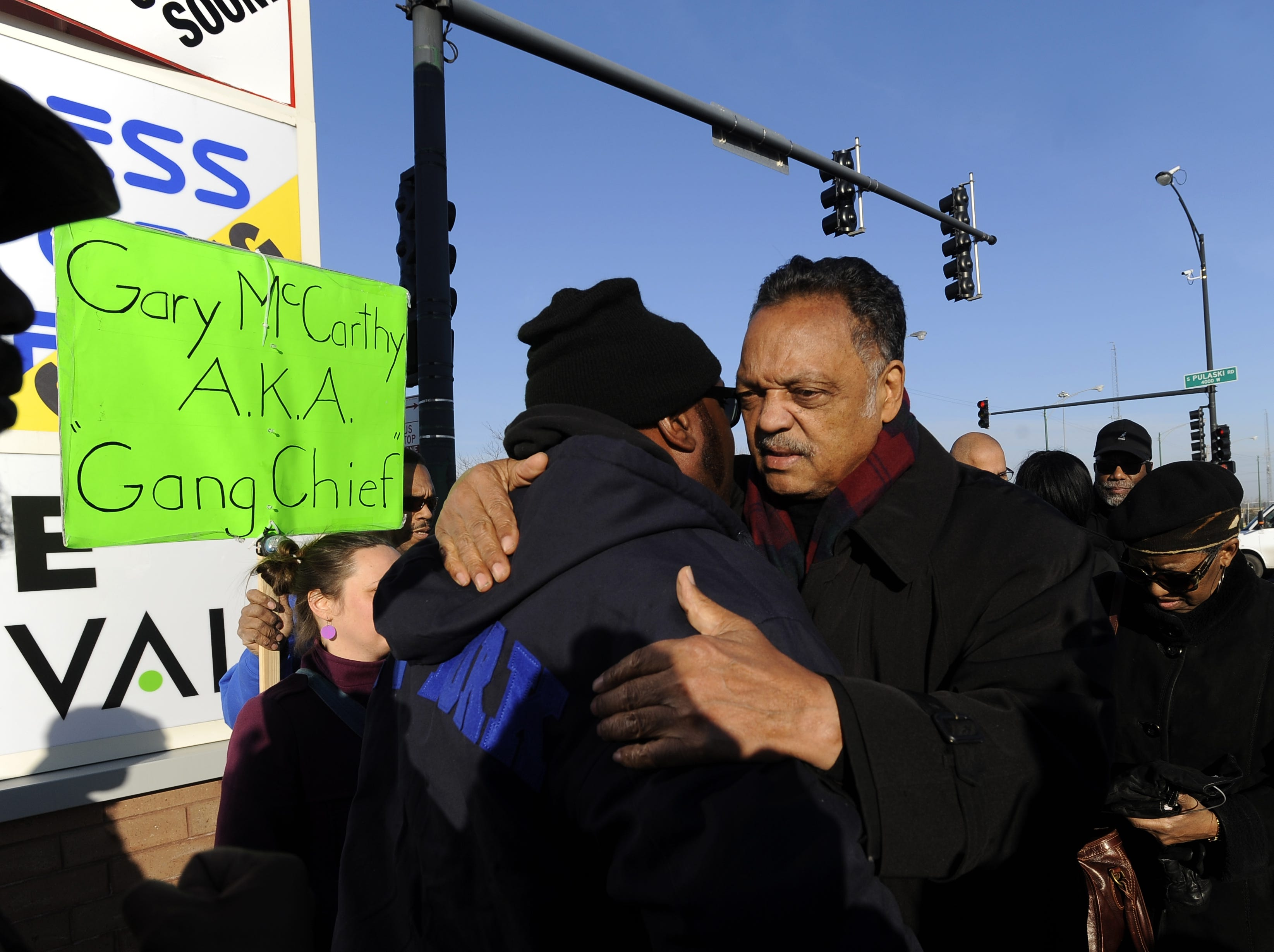 Rev. Jesse Jackson right, hugs Fred Hampton Jr., left, after a vigil for 17-year-old Laquan McDonald, who was fatally shot and killed Oct. 20, 2014 in Chicago. Chicago police Officer Jason Van Dyke was charged Tuesday, Nov. 24, 2015, with first degree murder in the killing.  Hampton's father Fred Hampton Sr. was the Illinois chapter President of the Black Panther Party and was shot and killed in 1969.