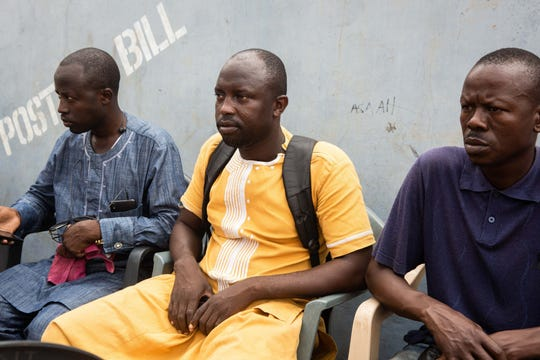 Mansuru Tahiru, the cousin of murdered Ghanian undercover reporter Ahmed Hussein-Suale, sits with friends during a mourning gathering in Accra on January 17, 2019.