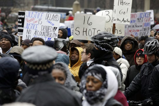"In this Nov. 27, 2015, file photo, protesters take part in a ""march for justice"" in Chicago, in the wake of the release of video showing an officer fatally shooting Laquan McDonald."