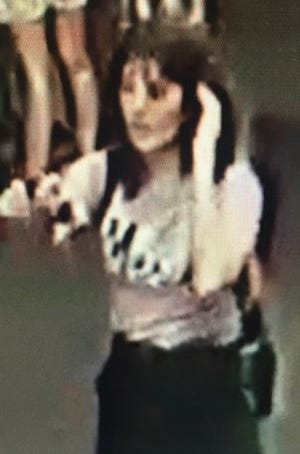Aiia Maasarwe is seen in CCTV images on the night she was killed. Victoria Police released the images Thursday in a plea for help from the public to solve the case.