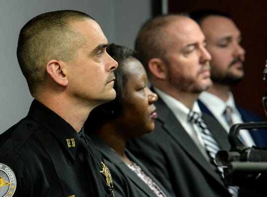 Capt. Bill Vaughn, left, Demika Patterson, Sgt. Kevin Matheson, and Sgt. J.T. Foster during a mental health screening initiative press conference at the Anderson County Sheriff's Office Friday, January 18, 2019.