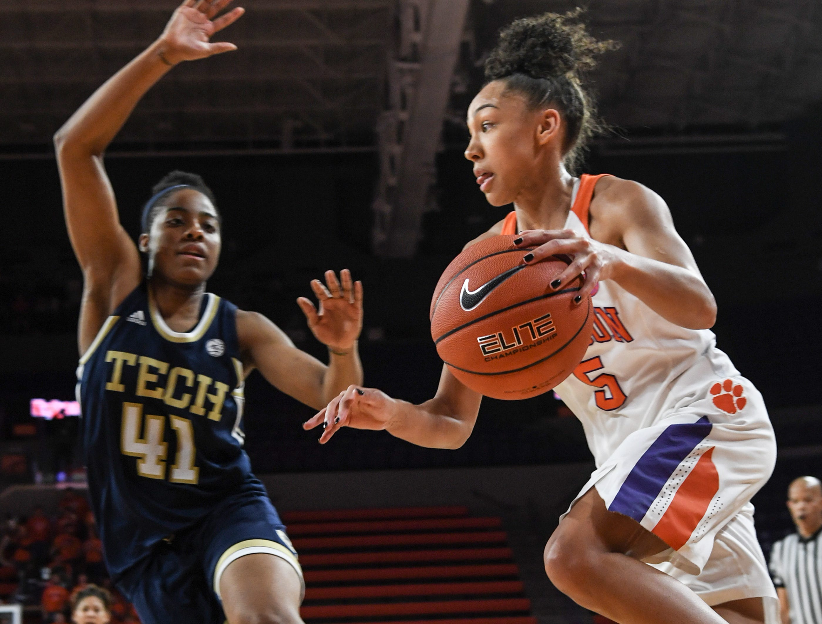 Clemson guard Danielle Edwards(5) dribbles near Georgia Tech guard Kierra Fletcher(41) during the fourth quarter at Littlejohn Coliseum in Clemson Thursday, January 17, 2019.