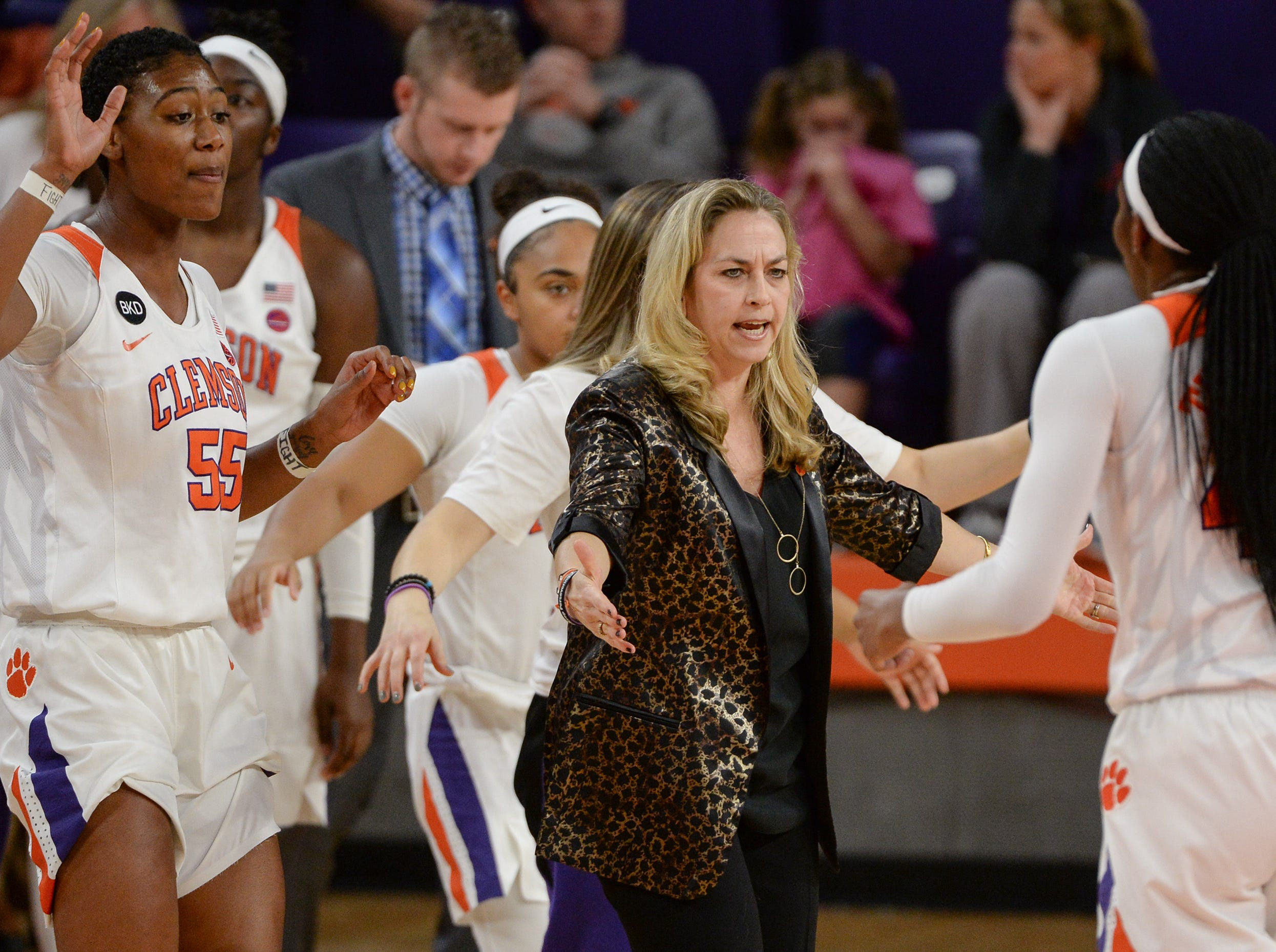 Clemson Head Coach Amanda Butler greets Clemson center Kobi Thornton(44) and teammates at a break during the second quarter at Littlejohn Coliseum in Clemson Thursday, January 17, 2019.