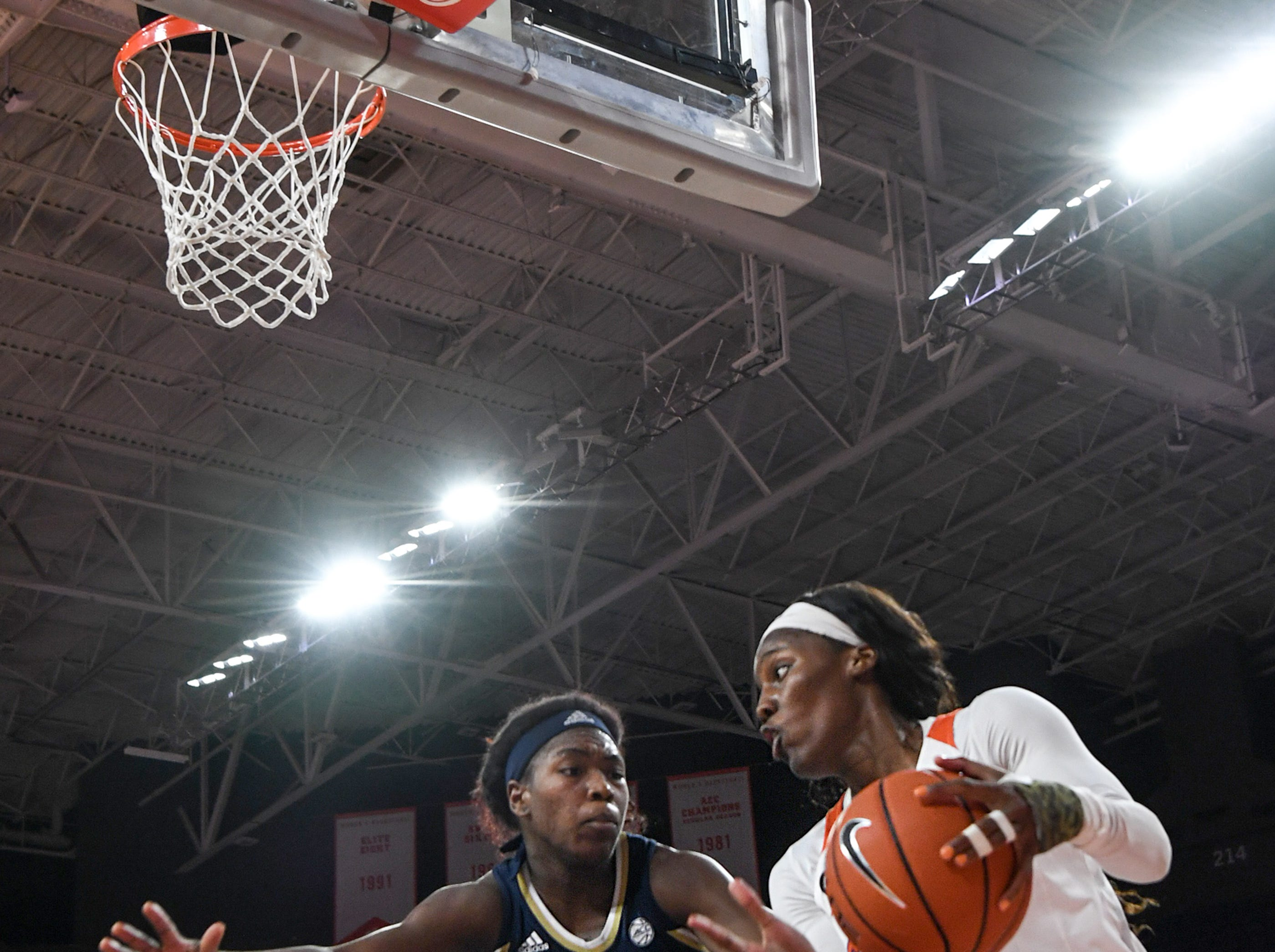 Clemson guard Aliyah Collier(12) dribbles near Georgia Tech guard Chanin Scott(24) during the fourth quarter at Littlejohn Coliseum in Clemson Thursday, January 17, 2019.