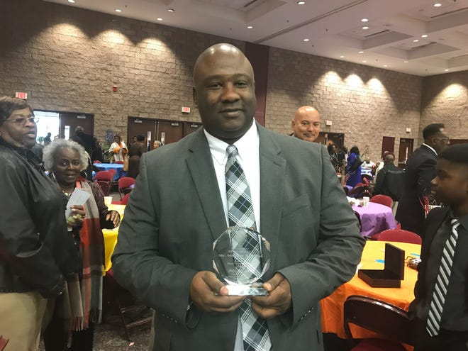 Gregory Floyd, one of William Floyd's sons, accepts the Community Trailblazer award in his father's honor at the 2019 Mayor's Martin Luther King Jr. Breakfast.