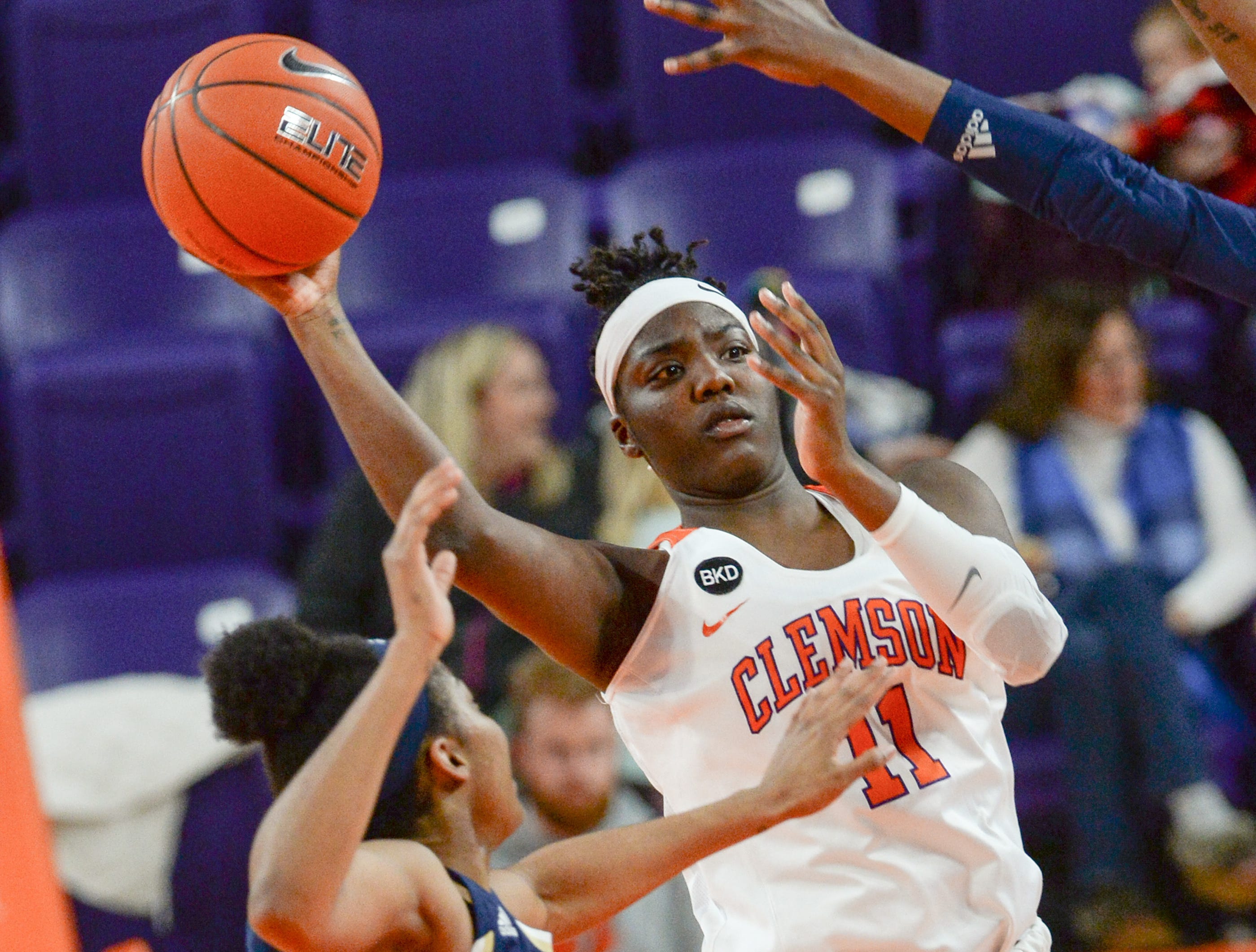Clemson forward Taylor Hosendove(11) passes near Georgia Tech guard Liz Balogun(5) during the second quarter at Littlejohn Coliseum in Clemson Thursday, January 17, 2019.