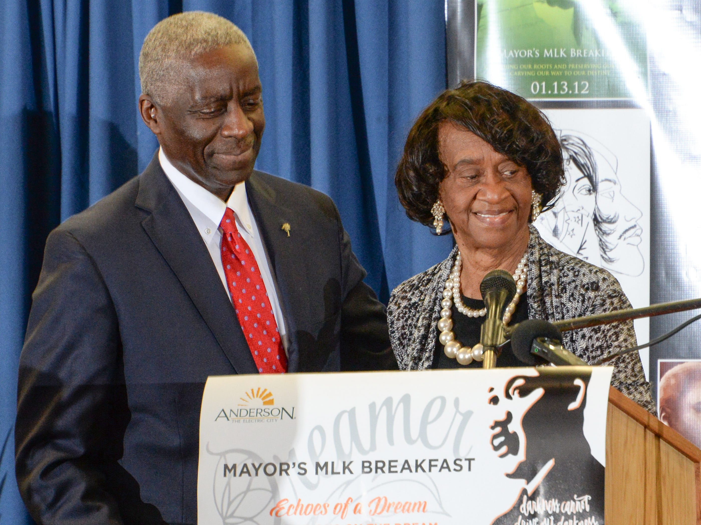 Mayor Terence Roberts follows Mayor Pro Tem Beatrice Thompson, right, with a keynote speech during the Mayor's Martin Luther King Jr Breakfast in the Anderson Civic Center Friday, January 18, 2019.