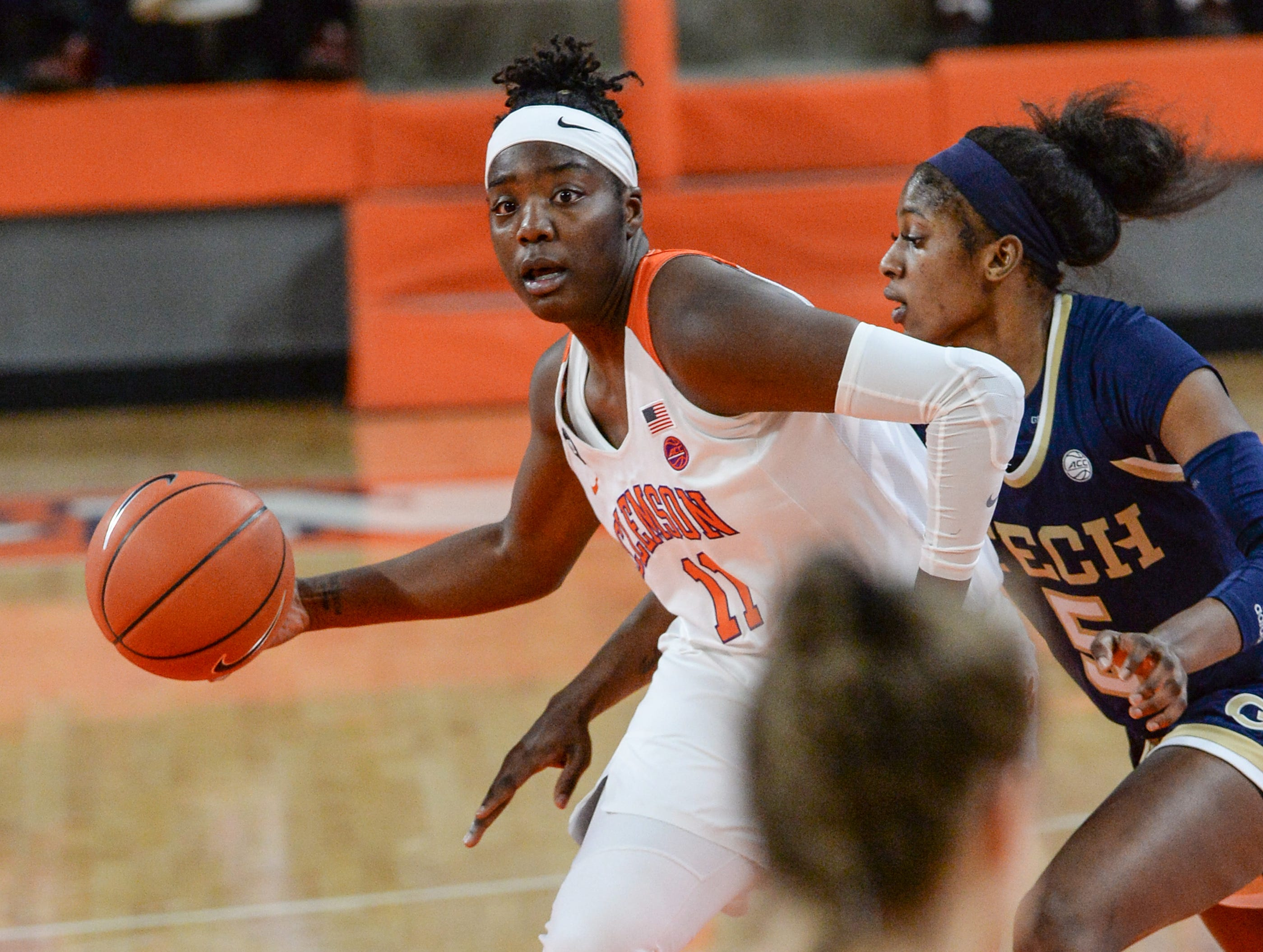 Clemson forward Taylor Hosendove(11) dribbles near Georgia Tech guard Liz Balogun(5) during the second quarter at Littlejohn Coliseum in Clemson Thursday, January 17, 2019.