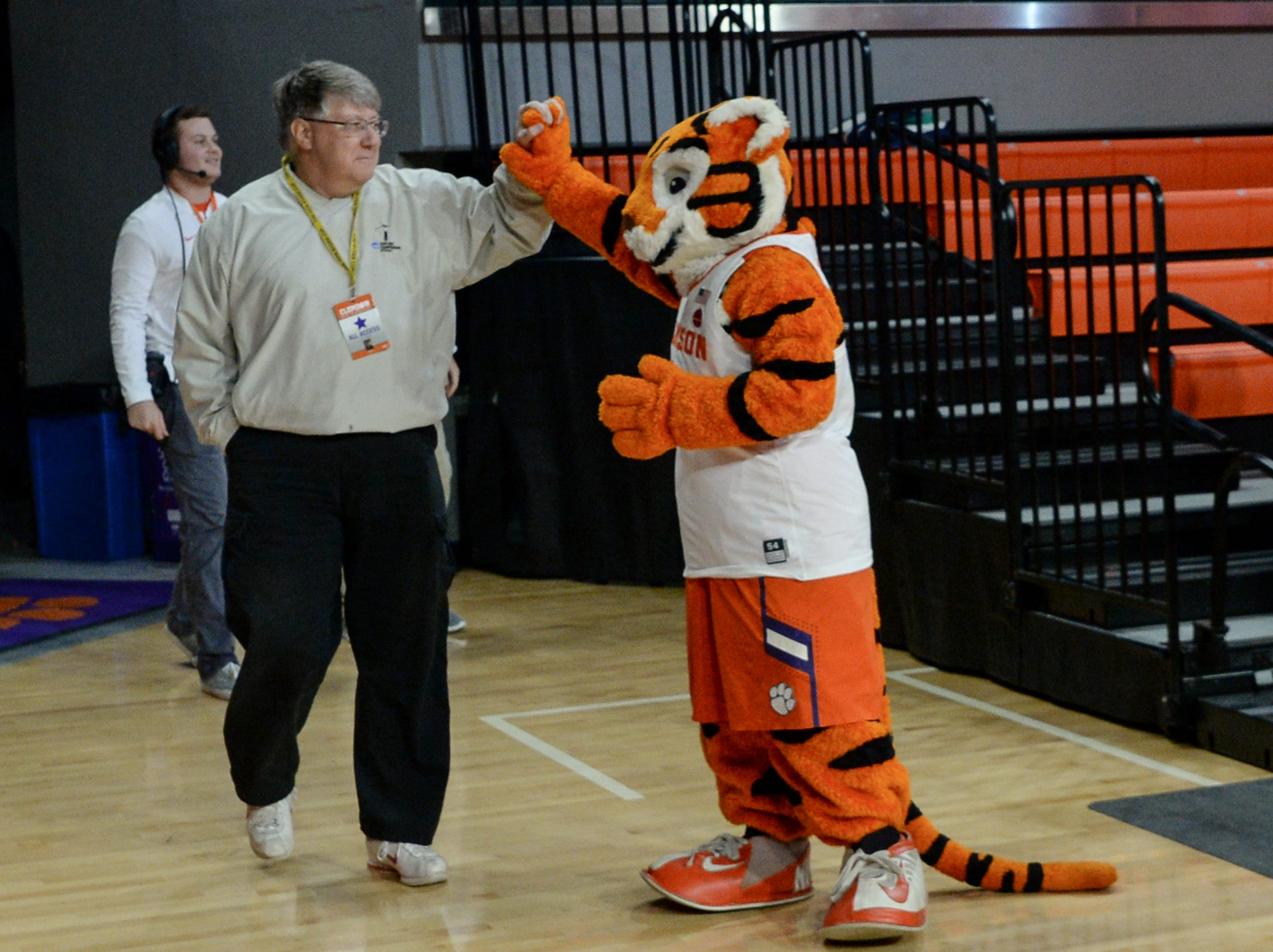 Tim Bourret exchanges high-five with the Tiger Cub before the first half of the Clemson and Georgia Tech women's game at Littlejohn Coliseum in Clemson Thursday, January 17, 2019. Clemson won 71-61.
