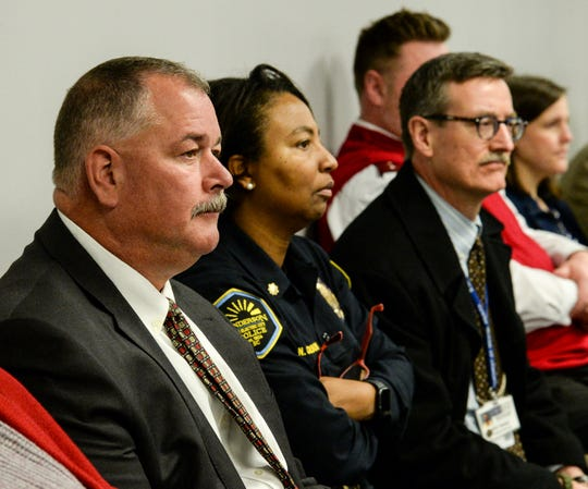 Tenth Circuit Solicitor David Wagner listens to Capt. Bill Vaughn speak during a mental health screening initiative press conference at the Anderson County Sheriff's Office Friday, January 18, 2019.