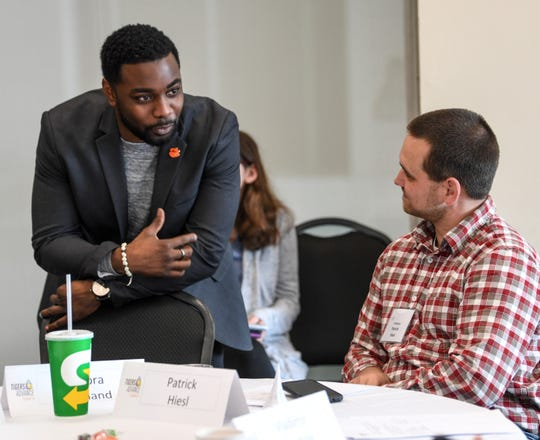 Maurice Williams, left, one of several faculty trailblazers participating in the Tigers Advance Clemson event, speaks with Patrick Hiesl in a room at the Hendrix Student Center on campus Friday, January 18, 2019.