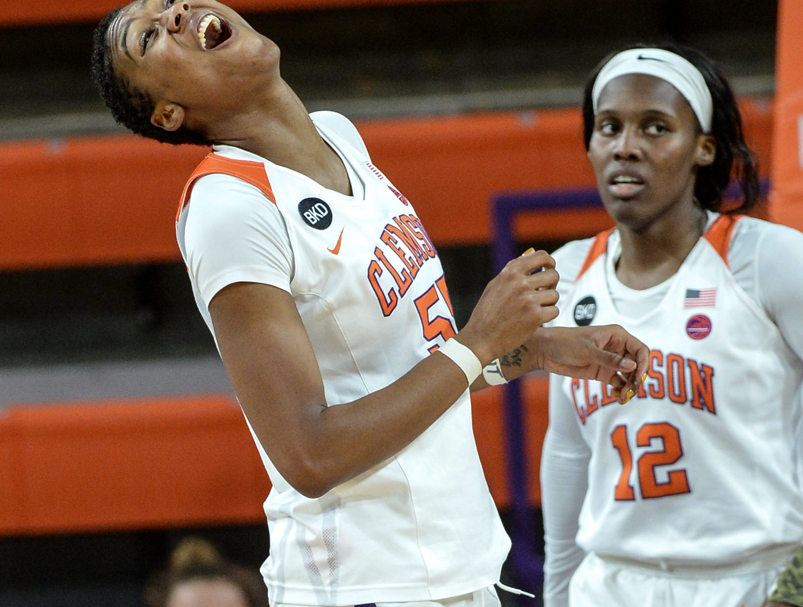 Clemson center Tylar Bennett(55) reacts after being called for a foul near teammate Aliyah Collier(12) during the fourth quarter at Littlejohn Coliseum in Clemson Thursday, January 17, 2019.