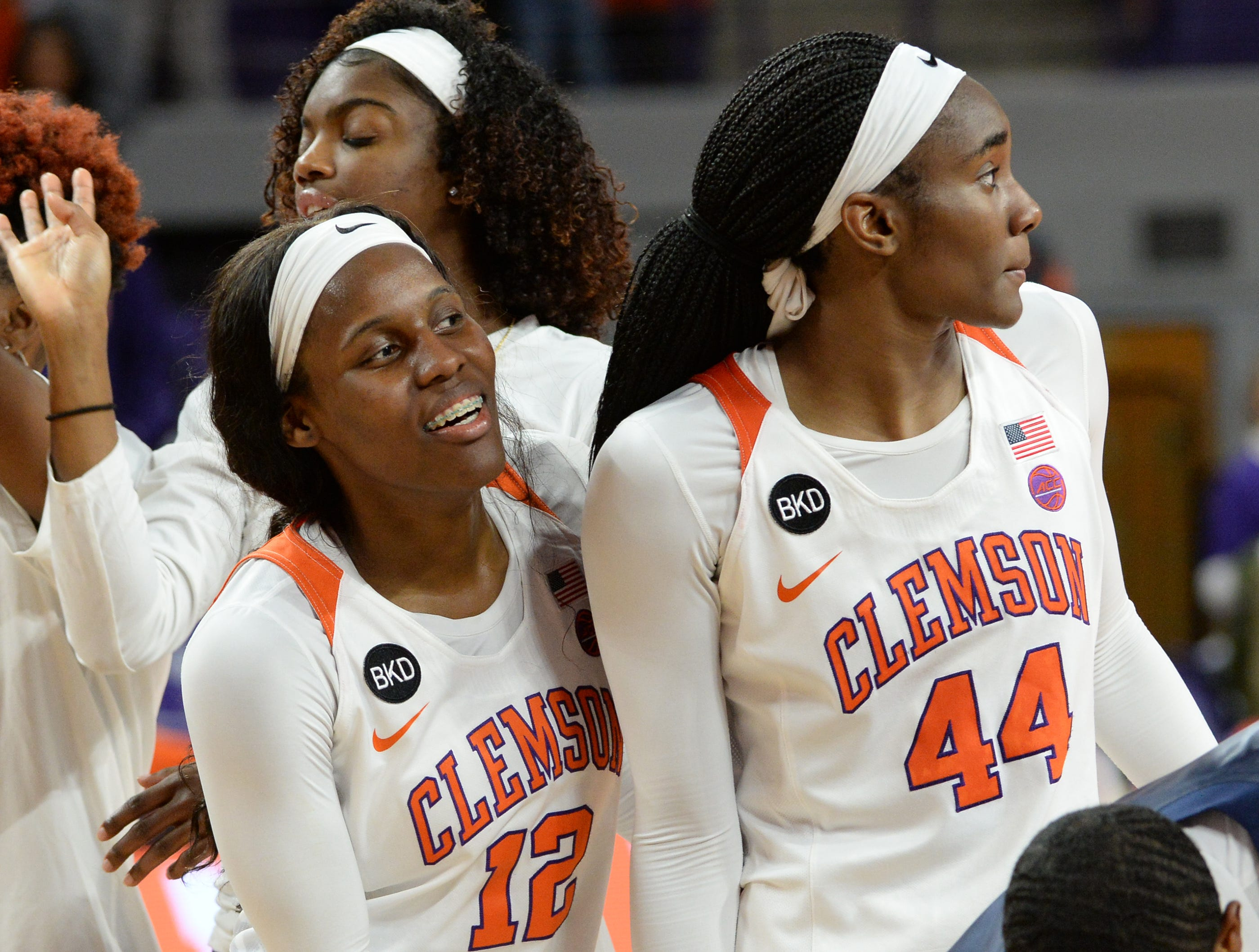 Clemson guard Aliyah Collier(12) celebrates with center Kobi Thornton(44) and teammates a 71-61 win over Georgia Tech after the gameat Littlejohn Coliseum in Clemson on Thursday, January 17, 2019.