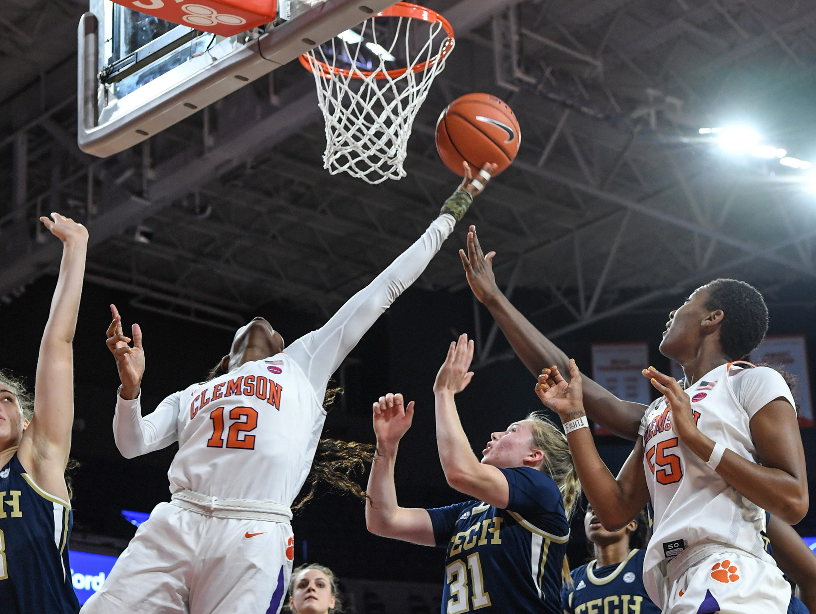 Clemson guard Aliyah Collier(12) shoots near Georgia Tech guard Lotta-Maj Lahtinen(31) during the fourth quarter at Littlejohn Coliseum in Clemson Thursday, January 17, 2019.