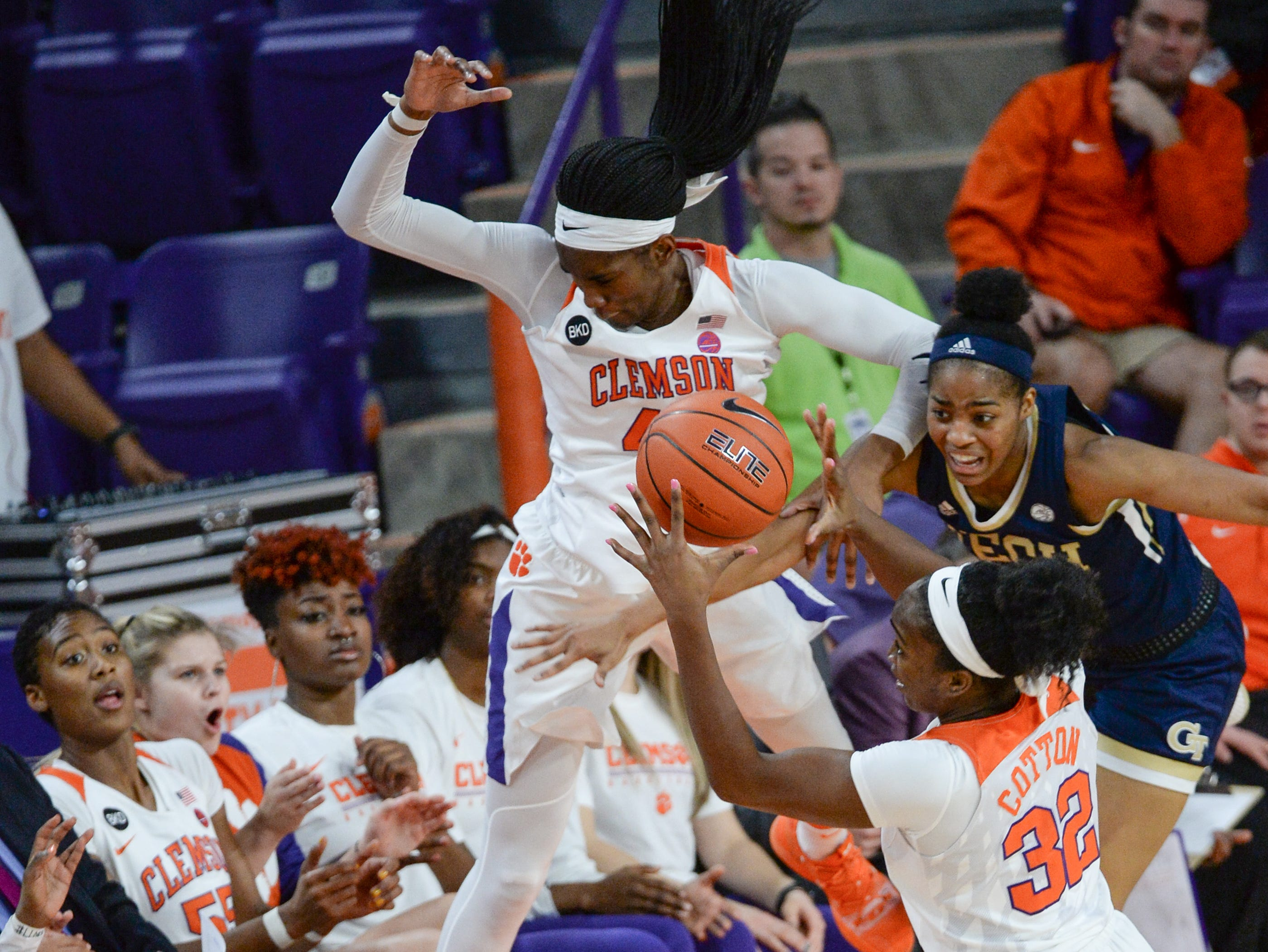 Clemson center Kobi Thornton(44) saved a ball, passing to teammate Clemson guard Chyna Cotton(32) near Georgia Tech guard Liz Balogun(5) during the first quarter at Littlejohn Coliseum in Clemson Thursday, January 17, 2019.
