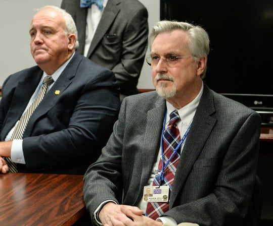 Kevin Hoyle, executive director of the Anderson-Oconee-Pickens Mental Health Center,  listens with Sen. Mike Gambrell, left, as Capt. Bill Vaughn speaks during a news conference at  the Anderson County Sheriff's Office Friday, January 18, 2019.